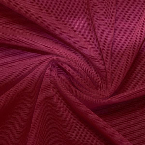A swirled piece of nylon spandex power mesh in the color ebi burgundy.