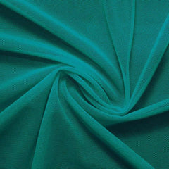 A swirled piece of nylon spandex power mesh in the color emerald.