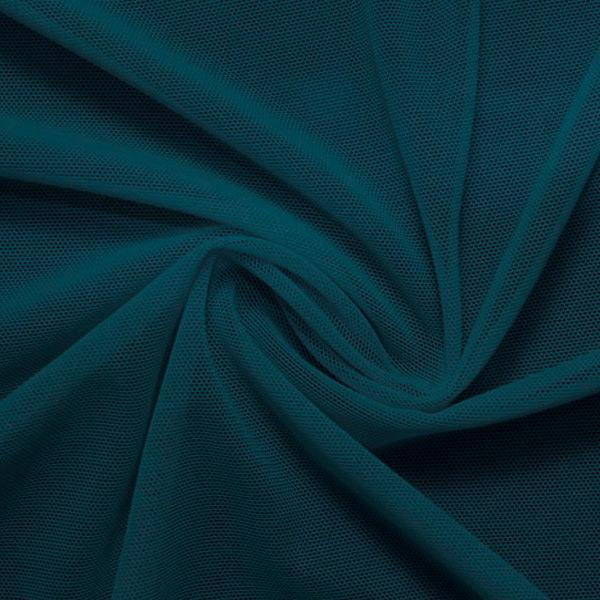 A swirled piece of nylon spandex power mesh in the color fiji.