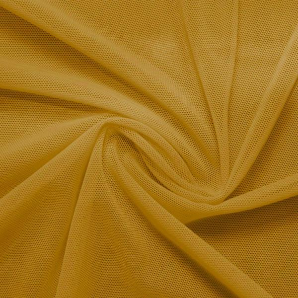 A swirled piece of nylon spandex power mesh in the color golden.