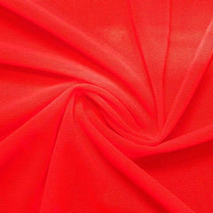 A swirled piece of nylon spandex power mesh in the color hot coral.