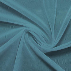 A swirled piece of nylon spandex power mesh in the color jean.