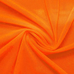 A swirled piece of nylon spandex power mesh in the color juicy tangerine.