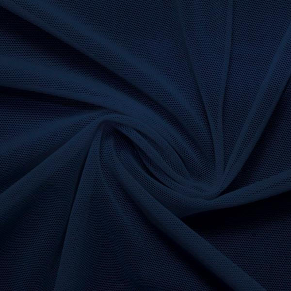 A swirled piece of nylon spandex power mesh in the color marine navy.
