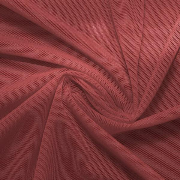 A swirled piece of nylon spandex power mesh in the color mars.