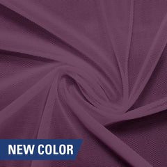 A swirled piece of nylon spandex power mesh in the color melody.