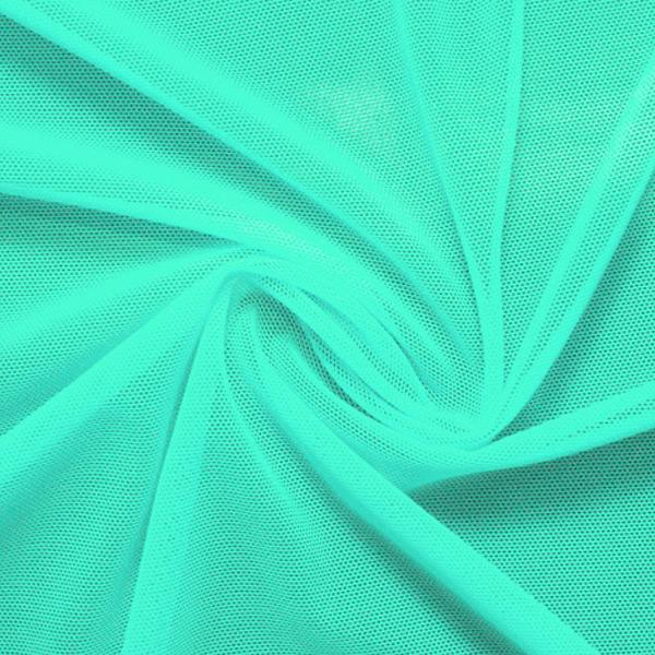 A swirled piece of nylon spandex power mesh in the color menthol.