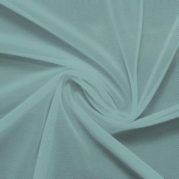 A swirled piece of nylon spandex power mesh in the color moonstone.