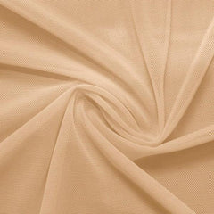 A swirled piece of nylon spandex power mesh in the color naked.