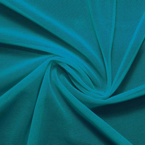 A swirled piece of nylon spandex power mesh in the color new jade.