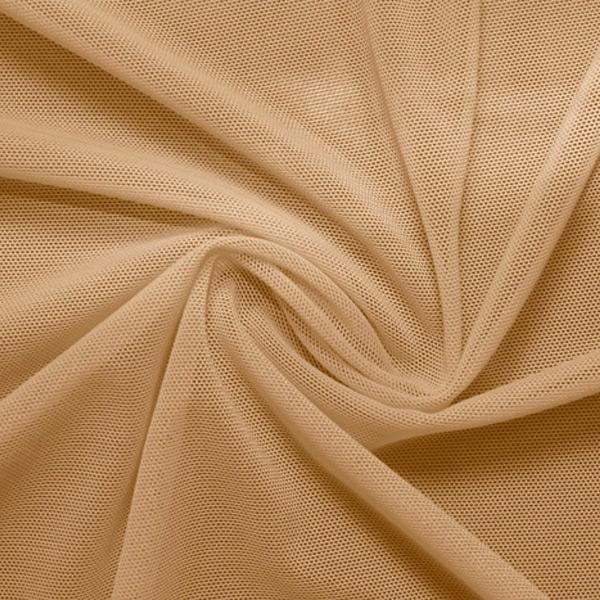 A swirled piece of nylon spandex power mesh in the color nude.