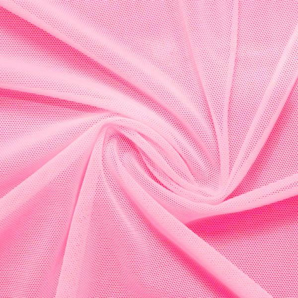 A swirled piece of nylon spandex power mesh in the color pink.