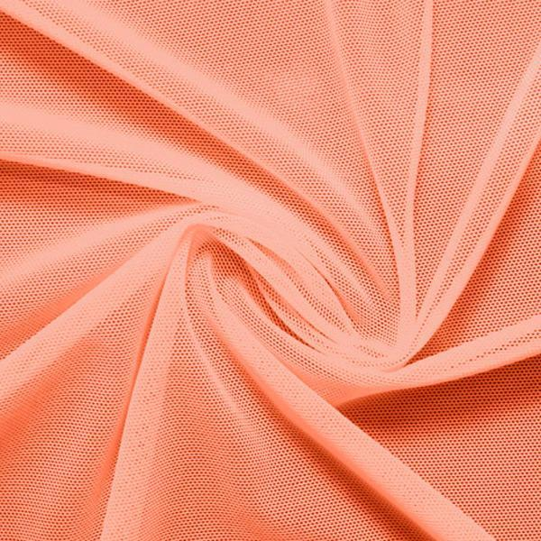 A swirled piece of nylon spandex power mesh in the color peach.