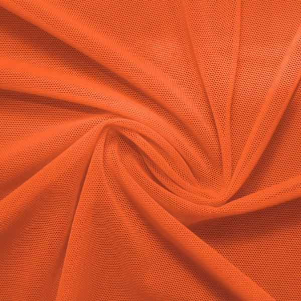 A swirled piece of nylon spandex power mesh in the color penny.