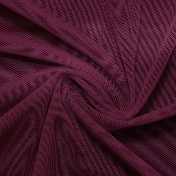 A swirled piece of nylon spandex power mesh in the color plum gorgeous.