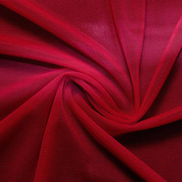 A swirled piece of nylon spandex power mesh in the color scarlet.