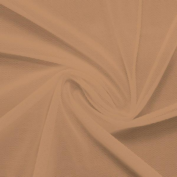 A swirled piece of nylon spandex power mesh in the color sun beige.