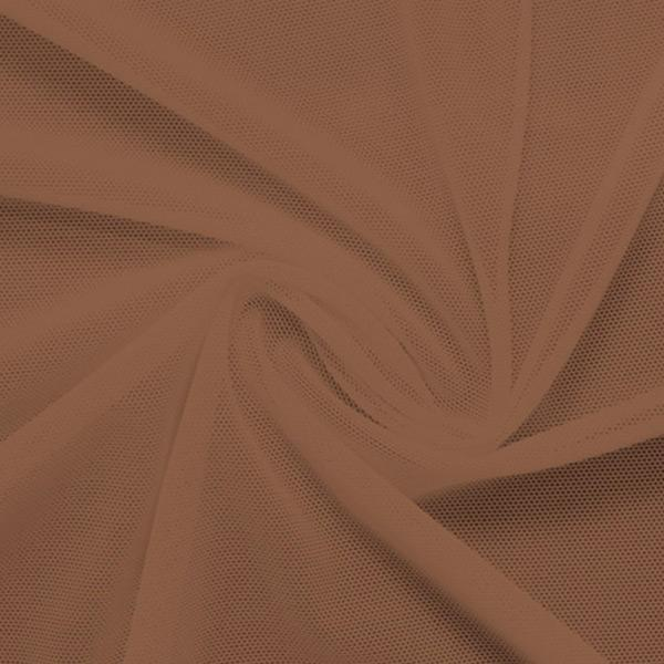 A swirled piece of nylon spandex power mesh in the color sweet syrup.