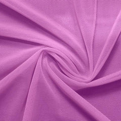A swirled piece of nylon spandex power mesh in the color wild orchid.
