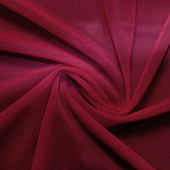 A swirled piece of nylon spandex power mesh in the color wine.