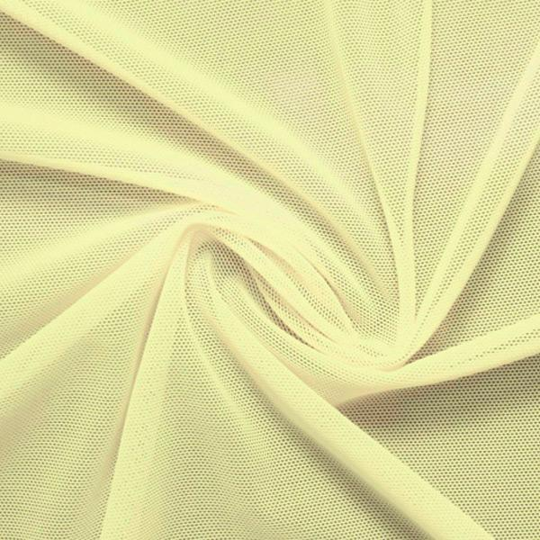 A swirled piece of nylon spandex power mesh in the color yellow.
