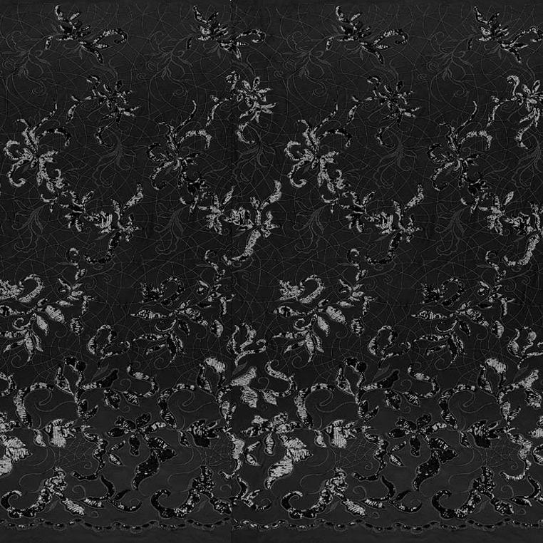 A panel of Renaissance, an embroidered design of leaves and vines with black sequin on a black stretch mesh base.