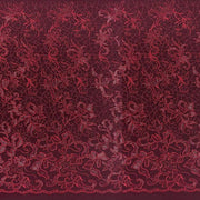 A panel of Renaissance, an embroidered design of leaves and vines with burgundy sequin on a burgundy stretch mesh base.