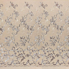 A panel of Renaissance, an embroidered design of leaves and vines with champagne-colored sequin on a champagne stretch mesh base.