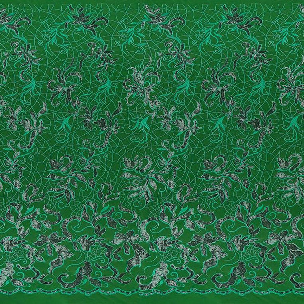 A panel of Renaissance, an embroidered design of leaves and vines with green sequin on a green stretch mesh base.