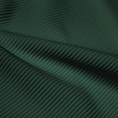 A rippled piece of Ribbed Spandex in the color apline green.