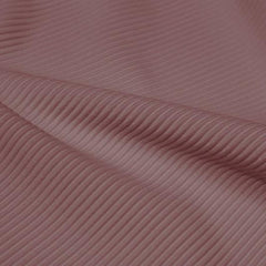 A rippled piece of Ribbed Spandex in the color antique rose.