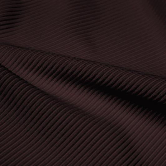 A rippled piece of Ribbed Spandex in the color brown.