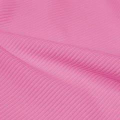A rippled piece of Ribbed Spandex in the color bubblegum.