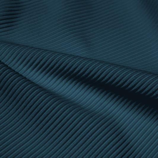 A rippled piece of Ribbed Spandex in the color empathy.