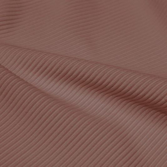 A rippled piece of Ribbed Spandex in the color fawn.