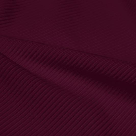 A rippled piece of Ribbed Spandex in the color fig.