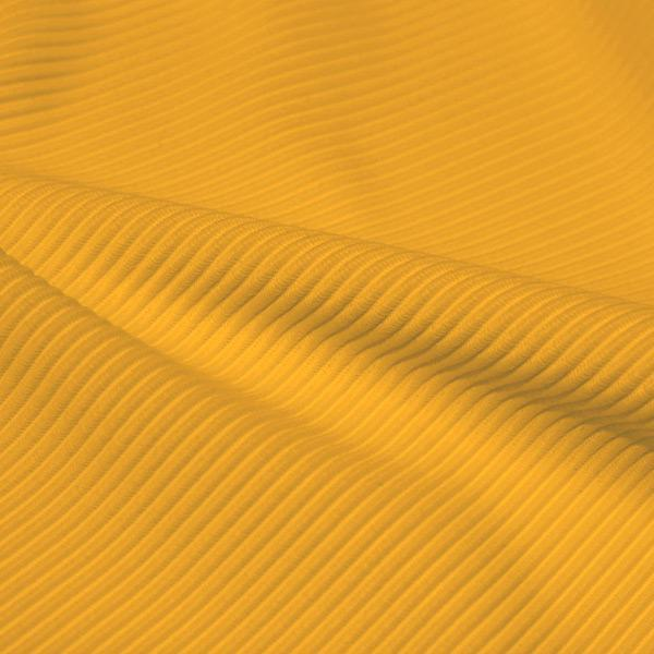 A rippled piece of Ribbed Spandex in the color halel yellow.