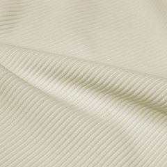 A rippled piece of Ribbed Spandex in the color ivory.