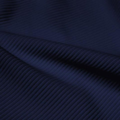 A rippled piece of Ribbed Spandex in the color marine navy.