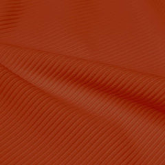 A rippled piece of Ribbed Spandex in the color penny.