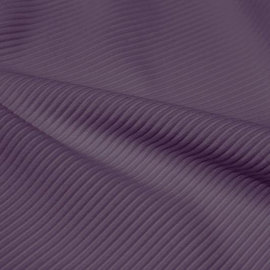 A rippled piece of Ribbed Spandex in the color purple haze.