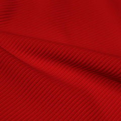 A rippled piece of Ribbed Spandex in the color red.