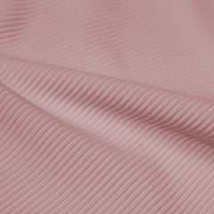 A rippled piece of Ribbed Spandex in the color rosy peach.