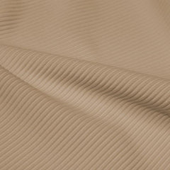 A rippled piece of Ribbed Spandex in the color taupe.