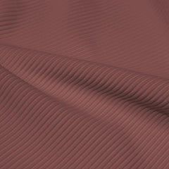 A rippled piece of Ribbed Spandex in the color toast.