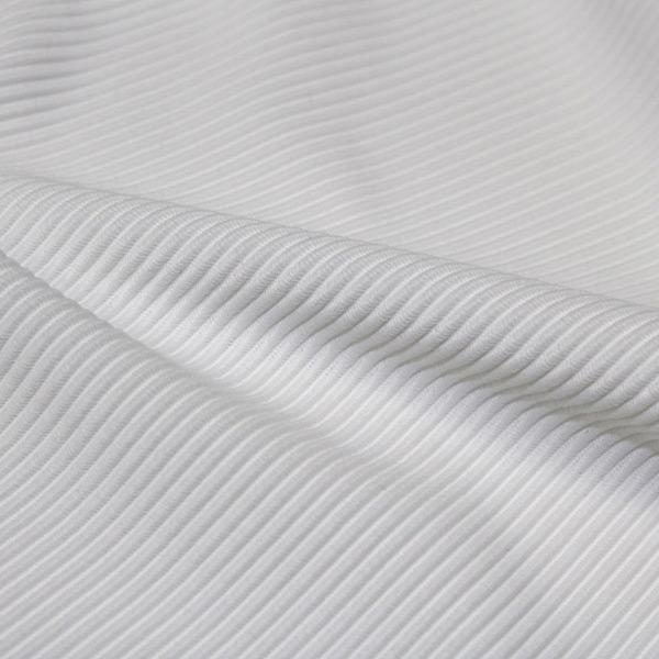 A rippled piece of Ribbed Spandex in the color white.