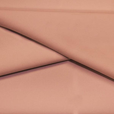 A folded piece of Ripple Recycled Polyester Spandex in the color rosy peach.