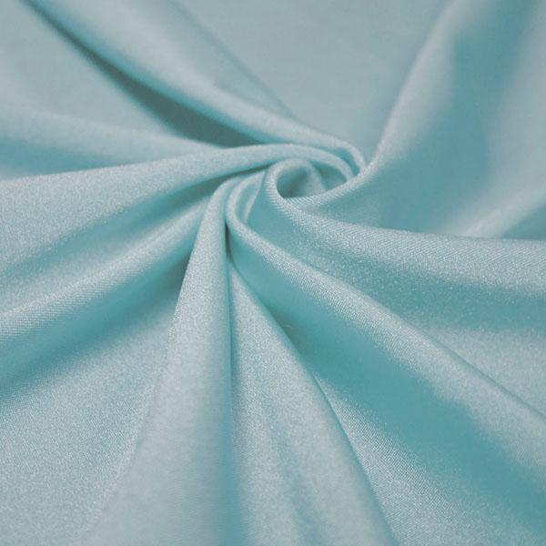 A swirled piece of shiny nylon spandex in baby blue.