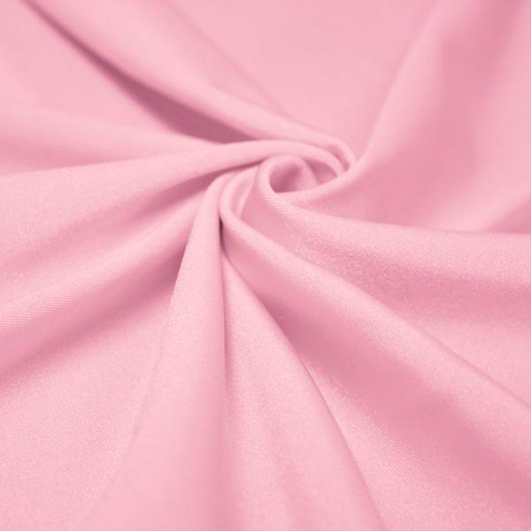 A swirled piece of shiny nylon spandex in baby pink.