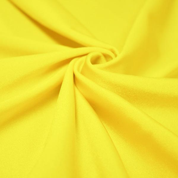 A swirled piece of shiny nylon spandex in electric yellow.